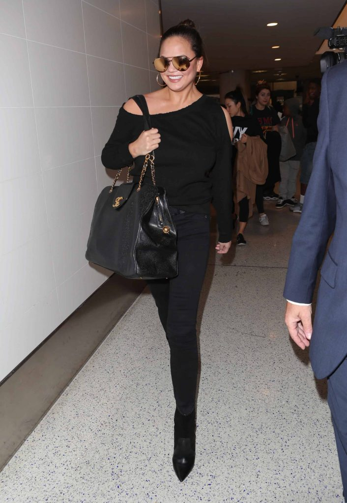 Chrissy Teigen's Cold Shoulder Sweater Look for Less!
