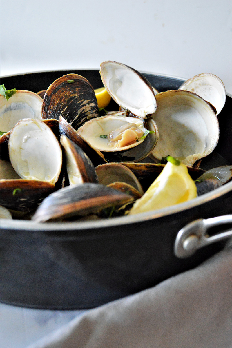 Bring to a gentle boil.  Cover and continue to cook for another 7-8 minutes (or until the clams have opened).