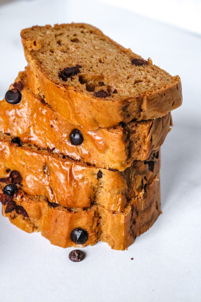 This keto cookie dough bread has just 4 ingredients. It's a flourless sweet loaf that makes the perfect homemade food gift too. Cookie Dough Bread What is cookie dough bread? Well, if you haven't tried to bake cookie dough in the shape of a loaf, then you are missing out on one of the best ways to enjoy it! This tastes like a soft and chewy peanut butter cookie. It melts in your mouth! But even better is how good it is for you. Peanut butter is high in healthy fats and protein, and it makes up the bulk of this loaf recipe. Flourless Cookie Dough There really isn't any flour in this dough. It's crazy to think of, but there isn't. The combination of baking soda, peanut butter, and eggs creates a fluffy quick bread. If you wanted to, you could make drop cookies with this dough, or even some l0w-carb dessert bars. It's a very versatile recipe that you can use in a variety of ways. Keto Peanut Butter Cookie Loaf This is the perfect thing to serve at your next brunch. Serve it with some chaffles, bacon, and eggs, and you have a perfect low-carb feast! This cookie loaf also tastes amazing with a keto pumpkin cream cold brew. It's a wonderful way to start your day. Since this has so much protein and healthy fat in it, you can also enjoy a slice after your workout. It doesn't need to be refrigerated, but it will last longer if you do. Either store it wrapped in plastic wrap at room temperature for up to 5 days or store it in the refrigerator for up to 2 weeks. Gluten-Free Sweet Bread Serve this sweet bread as dessert at your next party. Or bake it in a muffin tin and make individually-portioned muffins that are ready for the party without any extra effort. I didn't use any sugar substitute in this loaf. Nope! The peanut butter is sweet enough, and Lily's sugar-free chocolate chips added just enough sweet tastes to make it perfect. If you wanted to add a little sweetener to it, then only add a small amount of your favorite liquid or granular sugar substitute. It won't need mu